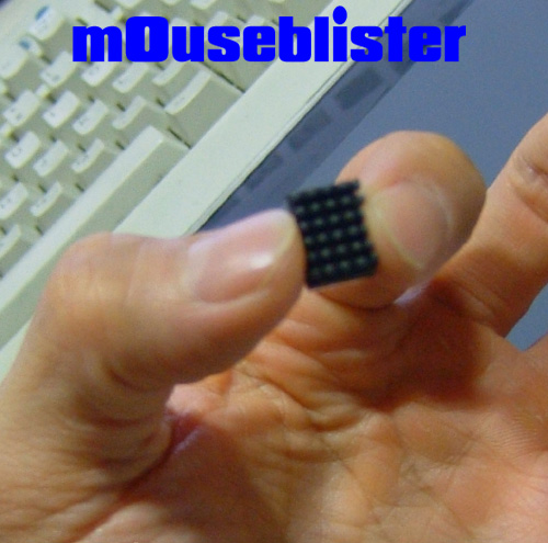 mouseblister.com held between thumb and forefinger